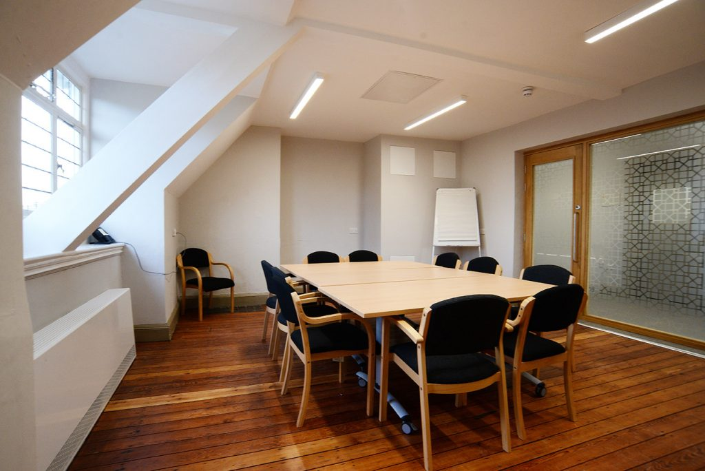 The Settlement Room at Oxford House - boardroom style set up